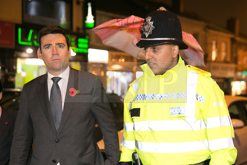 © Licensed to London News Pictures. 03/11/2015. Alum Rock, Birmingham, UK. Shadow Home Secretary ANDY BURNHAM visiting Alum Rock in Birmingham to launch the Labour Policy on Policing. Pictured, ANDY BURNHAM, left, talking to Sgt IFTI ALI, on the Alum Rock Road. Photo credit : Dave Warren/LNP