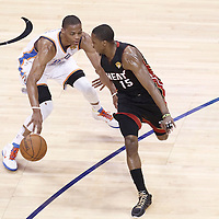 14 June 2012: Miami Heat point guard Mario Chalmers (15) defends on Oklahoma City Thunder point guard Russell Westbrook (0) during the Miami Heat 100-96 victory over the Oklahoma City Thunder, in Game 2 of the 2012 NBA Finals, at the Chesapeake Energy Arena, Oklahoma City, Oklahoma, USA.