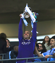 LONDON, ENGLAND - Sunday, February 28, 2016: Manchester City's goalkeeper Willy Caballero lifts the Cup after beating Liverpool on penalties during the Football League Cup Final match at Wembley Stadium. (Pic by John Walton/Pool/Propaganda)