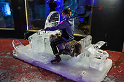 "A boy rides a snowmobile made of ice. The Lacey Street Theatre building, now hosting the Fairbanks Ice Museum, is an Art Deco architectural showpiece theatre located at 500 Second Avenue in Fairbanks, Alaska. It was designed by noted theatre designer B. Marcus Priteca, and built in 1939 by C.W. Hufeisen for Austin E. ""Cap"" Lathrop. To license this Copyright photo, please inquire at PhotoSeek.com."