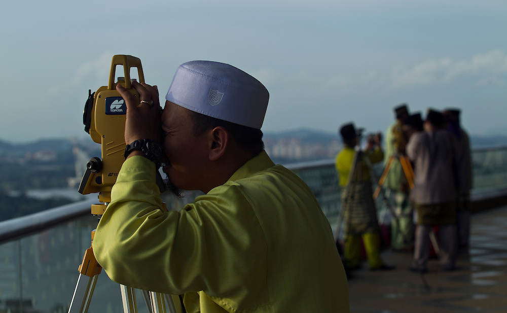 Malaysia's Islamic authority member performing 'Rukyah' to sight for the new moon of Ramadan in Putrajaya, Malaysia. Muslims scan for the sky to sight the new moon that indicates the beginning of the new month of Ramadan. During Ramadan. Muslims across the world will perform the obligatory worship in the form of fasting abstaining from food, drink and sexual intercourse from dawn to sunset, for the whole month.
