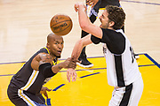 Golden State Warriors forward David West (3) fouls San Antonio Spurs center Pau Gasol (16) during Game 2 of the Western Conference Quarterfinals at Oracle Arena in Oakland, Calif., on April 16, 2018. (Stan Olszewski/Special to S.F. Examiner)