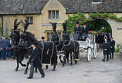 © London News Pictures. 08/06/2012. Thame, UK.  A horse drawn carriage carrying the coffin, leaving the home of former Bee Gee Robin Gibb on its way to St Mary's Church in Thame, Oxfordshire for the funeral of Robin Gibb on June 8, 2012. Robin Gibb died on May 20, 2012 aged 62 following a long battle against cancer. Photo credit: Ben Cawthra/LNP