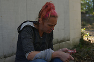 Tara, a mother of five, injects heroin in her vein by an abandoned garage in an alley in the South Side neighborhood of Hamilton, Ohio, where heroin addiction is rampant, part of a growing epidemic across the U.S. Tara, who did not want her last name used, often sleeps in these alleys, which are near the home where her two young children live with their father and his mother. She has lost her three other children to the social services system. Her children's father only allows her to visit two kids before 9 a.m., when she is still sober, and when she must clean their rooms.