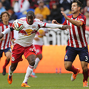 Bradley Wright-Phillips, (left), New York Red Bulls, is challenged by Carlos Bocanegra, Chivas USA, during the New York Red Bulls V Chivas USA, Major League Soccer regular season match at Red Bull Arena, Harrison, New Jersey. USA. 30th March 2014. Photo Tim Clayton