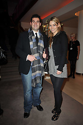 ZAFAR RUSHDIE and JESSICA POWNALL at the Krug Mindshare Charity Auction held at Christie's, 8 King Street, London SW1 on November 2009.
