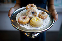 Jessica Salgado, of the Cafe, holds a platter of vegan donuts at New People, a five-story, glass-walled retail complex that holds a cafe, movie theater, five shops and a gallery, in Japantown, in San Francisco, Ca., on Saturday, May 29, 2010.