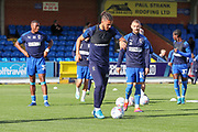 AFC Wimbledon defender Nesta Guinness-Walker (18) and AFC Wimbledon attacker Shane McLoughlin (19) warming up during the EFL Sky Bet League 1 match between AFC Wimbledon and Portsmouth at the Cherry Red Records Stadium, Kingston, England on 19 October 2019.