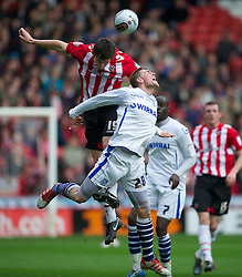 SHEFFIELD, ENGLAND - Saturday, March 17, 2012: Tranmere Rovers' Ryan Brunt in action against Sheffield United's Harry Maguire during the Football League One match at Bramall Lane. (Pic by David Rawcliffe/Propaganda)