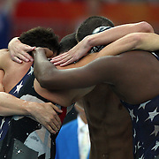 Garrett Weber-Gale, Jason Lezak, Michael Phelps and Cullen Jones of the United States celebrate finishing the Men's 4 x 100m Freestyle Relay Final in first place and to win the gold medal held at the National Aquatics Center on Day 3 of the Beijing 2008 Olympic Games on August 11, 2008 in Beijing, China. Photo Tim Clayton