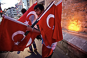 Gaziantep | 12 September 2015<br /> <br /> A young man is displaying turkish national flags for sale close to the historical market (bazar) in the center of the south-eastern turkish city of Gaziantep.<br /> Flags are waving all over the country to commemorate the killing of over 30 police officers in the struggle between the turkish government and kurdish so-called &quot;terrorist group&quot; PKK.<br /> <br /> &copy;peter-juelich.com<br /> <br /> [No Model Release | No Property Release]