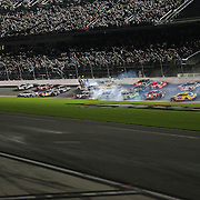 NASCAR Sprint Cup driver Austin Dillon (3) wrecks into the catch fence on the final lap of the 57th Annual NASCAR Coke Zero 400 stock car race at Daytona International Speedway on Monday, July 6, 2015 in Daytona Beach, Florida.  (AP Photo/Alex Menendez)