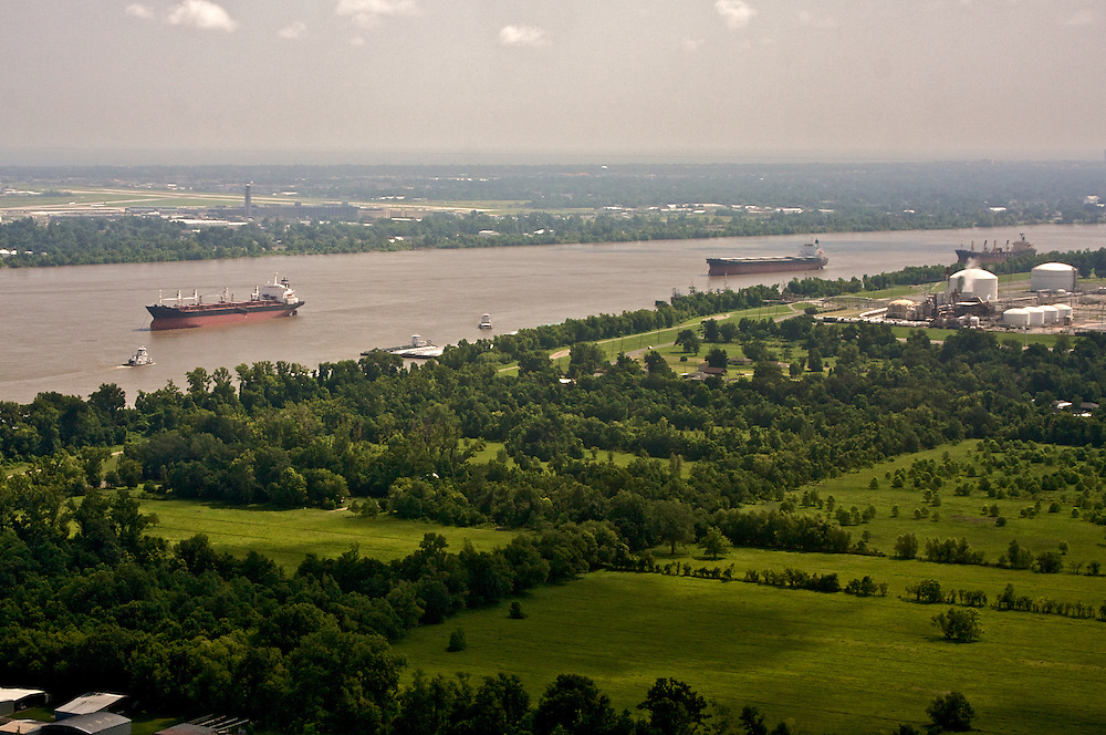 Ships head upriver on the Mississippi River at Ama, St. Charles Parish, Louisiana, USA