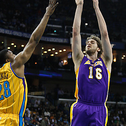 February 5, 2011; New Orleans, LA, USA; Los Angeles Lakers power forward Pau Gasol (16) shoots over New Orleans Hornets center D.J. Mbenga (28) during the first quarter at the New Orleans Arena.   Mandatory Credit: Derick E. Hingle
