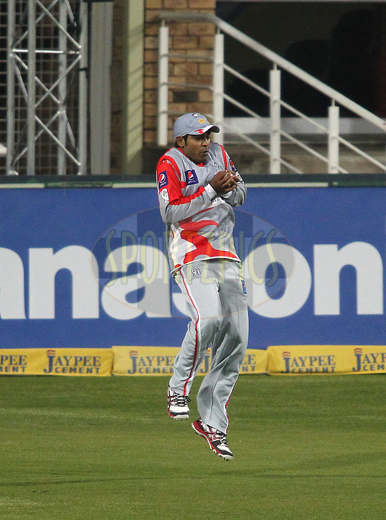 Haris Sohail of Sialkot Stallions takes the catch to get Liam Dawson of Hampshire Royals wicket during the 6th Qualifying match of the Karbonn Smart CLT20 South Africa between Hampshire and Sailkot Stallions held at The Wanderers Stadium in Johannesburg, South Africa on the 11th October 2012..Photo by Shaun Roy/SPORTZPICS/CLT20
