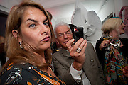 TRACEY EMIN; NICKY HASLAM, Party at the home of Amanda Eliasch in Chelsea after the opening of As I Like it. A memory by Amanda Eliasch and Lyall Watson. Chelsea Theatre. Worl's End. London. 4 July 2010<br /> <br />  , -DO NOT ARCHIVE-© Copyright Photograph by Dafydd Jones. 248 Clapham Rd. London SW9 0PZ. Tel 0207 820 0771. www.dafjones.com.