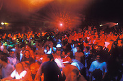 Crowded dancefloor bathed in red light, United Dance, U.K, 1990s.