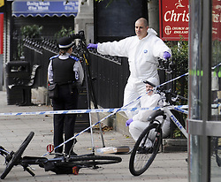 © Licensed to London News Pictures. 10/10/2011. London, UK. Police and forensics on  Broadway, Bexleyheath, South London today (10/10/2011) where a woman was killed in a stabbing this morning (10/10/2011). Photo credit : Grant Falvey/LNP