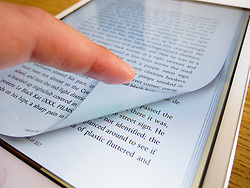 Detail of iPad mini screen showing iBooks e-book reader with page turning