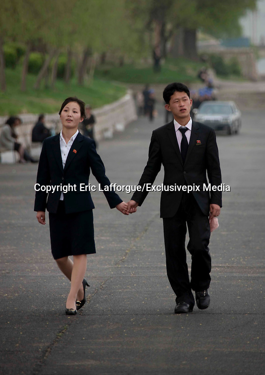 Swinging Pyongyang<br /> The hidden side of the North Korean Capital<br /> <br /> Most of the Medias show the images of poverty and dictatorship I. North Korea , but as told Me a defector , Nk is a real country with activities, culture, love , etc<br /> As China has started to overflow the country with products , you can clearly see the changes in pyongyang.<br /> Mobile phones are run by orascom Egypt company and millions have subscribed to it, even if calling abroad is impossible .<br /> The clothes have changed . When I came in 2008 everybody wore this vynalon clothes made in nk making them look like robots in the streetd as the tissue is not soft at all.<br /> Now fake products of American brands etc are everywhere .<br /> The attitude of people has also changed .<br /> Seeing young people together is more and more possible in the fun fairs for example.<br /> The huge park of the main fun fair has became a great rendez vous area for the young people.<br /> One of my guide who was 20 kept on texting , telling me that she was answering young students of her age who wanted a date.<br /> In 2008 my guide kept on telling me that this was forbidden for teens of same age to be together in the street.<br /> The food has also known a big change :<br /> You can have a pizza in Pyongyang made by à Nk cook who studied in Italy!<br /> If you are lucky enough to enter a luxury restaurant where the elite goes along taedong river , you will enjoy a really tasty food for 20 euros (locals pay less)<br /> In the shops too this is not a surprise to see computers for sale even if they are not the latest ones<br /> My guide told me Nk are crazy about exchanging USB keys that can contain so many movies, songs, and games .<br /> Since kin Jung un has been named as leader , lot of infrastructures have been built to make the country look like a western one. The first fitness center was aired hundreds of times in the Nk tv. Hard to imagine what may think the poor farmers of the country by
