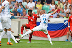 Raheem Sterling of England and Miso Brecko of Slovenia during the EURO 2016 Qualifier Group E match between Slovenia and England at SRC Stozice on June 14, 2015 in Ljubljana, Slovenia. Photo by Mario Horvat / Sportida