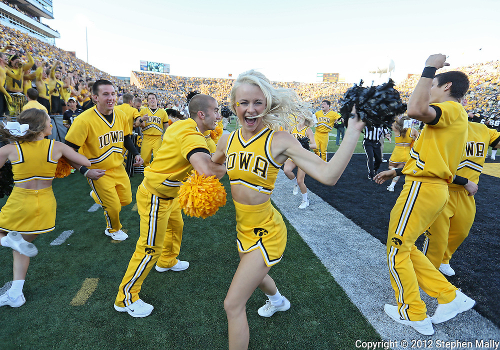 September 15 2012: Iowa Hawkeyes cheerleaders celebrate after the end of the NCAA football game between the Northern Iowa Panthers and the Iowa Hawkeyes at Kinnick Stadium in Iowa City, Iowa on Saturday September 15, 2012. Iowa defeated Northern Iowa 27-16.
