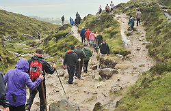 A steady flow of pilgrims perservered in the conditions despite the cancellation notices on  Croagh Patrick for Reek Sunday.<br /> Pic Conor McKeown