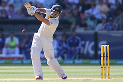 © Licensed to London News Pictures. 27/12/2013.  Mitchell Johnson batting during Day 2 of the Ashes Boxing Day Test Match between Australia Vs England at the MCG on 27 December, 2013 in Melbourne, Australia. Photo credit : Asanka Brendon Ratnayake/LNP