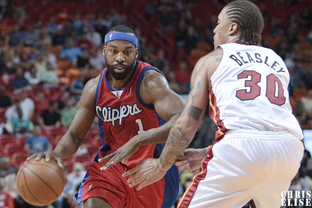 10 March 2010: Los Angeles Clippers guard Baron Davis drives past Miami Heat Michael Beasley during the Miami Heat 108-97 victory over the Los Angeles Clippers at the AmericaAirlines  Arena, in Miami, Florida, USA.