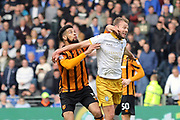 Hull City defender Michael Hector (5) and Sheffield Wednesday forward Jordan Rhodes (7) battles for possession  during the EFL Sky Bet Championship match between Hull City and Sheffield Wednesday at the KCOM Stadium, Kingston upon Hull, England on 14 April 2018. Picture by Mick Atkins.