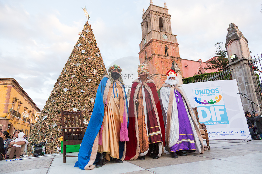Three Kings stand together during El Dia de Reyes in the historic Jardin January 6, 2016 in San Miguel de Allende, Mexico. The traditional festival marks the culmination of the twelve days of Christmas and commemorates the three wise men who traveled from afar, bearing gifts for the infant baby Jesus.