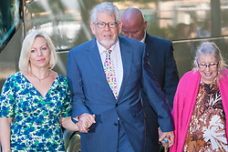 London, June 10th 2014. Veteran entertainer asnd artist Rolf Harris arrives at court with his daughter Bindi, left, his wife Alwen, as closing statements are expected in his trial on 12 counts of indecent assault against 4 girls aged 7 to 19.