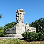 John Ericsson National Memorial Wide from Left. The John Ericsson National Memorial, on the bank of the Potomac River near the Lincoln Memorial, is a monument to Civil War naval engineer John Ericsson, the designer of the breakthrough iron-clad naval vessel USS Monitor. The memorial was designed by architect Albert Randolph Ross and sculpted by James Earle Fraser from the same pink granite used in the Lincoln Memorial. Because Ericsson was Swedish-born, the memorial consists of a combination of symbolic elements from his birthplace and his adopted homeland.