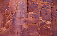 A red sandstone cliff wall in Arches National Park, Utah, USA.