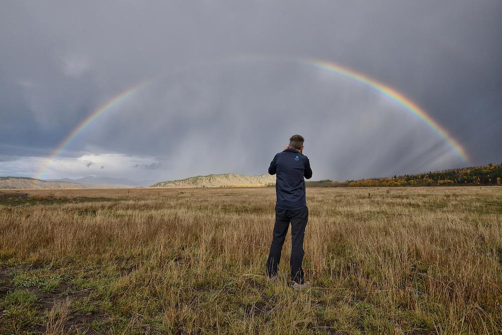 USA, Wyoming, Rockies, Rocky Mountains, Grand Teton National Park, photographer and rainbow