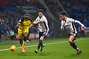Burton Albion striker Lucas Akins (10) controls the ball away from Bolton Wanderers midfielder Will Buckley (11) and Bolton Wanderers defender Antonee Robinson (15) during the EFL Sky Bet Championship match between Bolton Wanderers and Burton Albion at the Macron Stadium, Bolton, England on 16 December 2017. Photo by Richard Holmes.