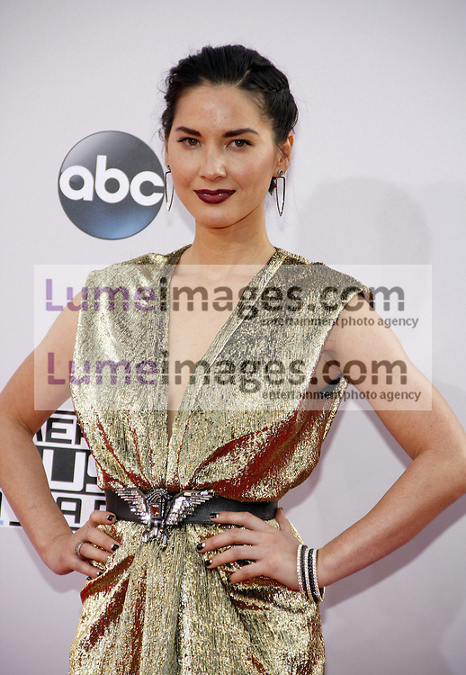 Olivia Munn at the 2014 American Music Awards held at the Nokia Theatre L.A. Live in Los Angeles on November 23, 2014 in Los Angeles, California. Credit: Lumeimages.com