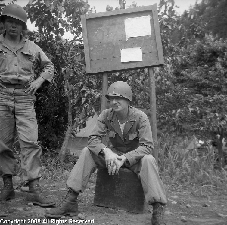 Two war weary members of the U.S. Army, Second Division relax at the unit's command post during the Korean War. These are photos of the 2nd Infantry Division in the Korean War in 1950 or 1951.