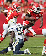 Kansas City Chiefs running back Jamaal Charles (25) slips past San Diego Chargers inside linebacker Donald Butler (56) as he rushes for a first down in the 3rd quarter of their NFL game, Sunday, Sept. 30, 2012, in Kansas City, Mo. Also pictured is Chiefs' quarterback Matt Casel (7).  (AP Photo/Colin E Braley)