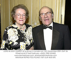 LORD & LADY OAKSEY at a dinner in London on 14th November 2001.			OUF 26