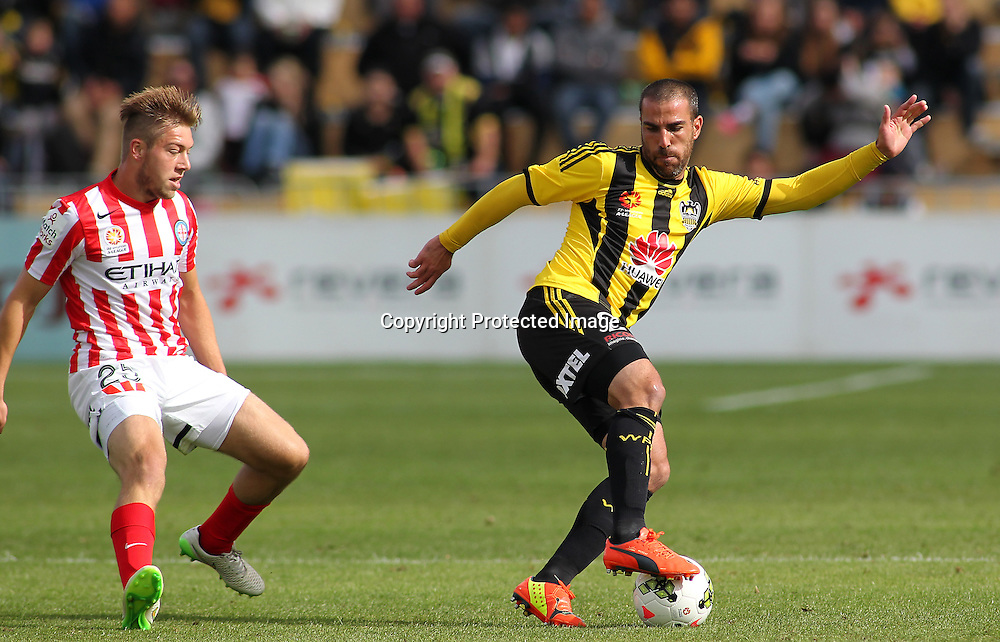 Phoenix' Emmanuel Muscat evades a defender during the A-League football match between the Wellington Phoenix & Melbourne City, at the Hutt Recreational Ground, Wellington, 14 February 2015. Photo.: Grant Down / www.photosport.co.nz