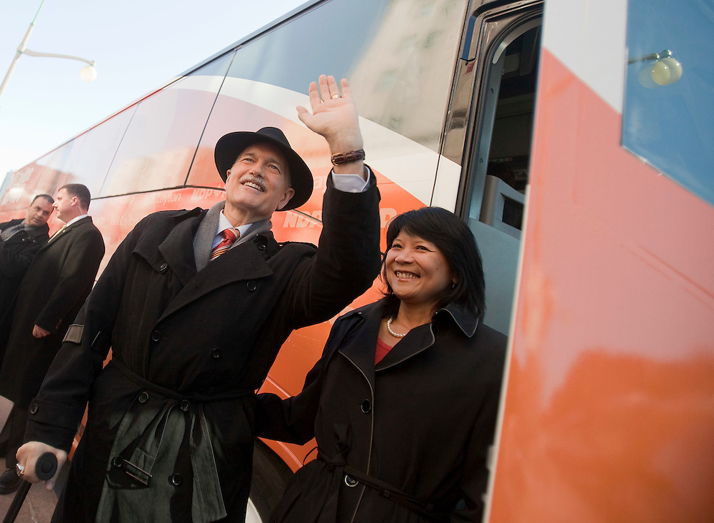 NDP leader Jack Layton waves to the crowd as he boards the bus following the NDP's campaign kickoff event at the Chateau Laurier in Ottawa, Ontario, March 26, 2011 following the fall of the Conservative government  Friday. Canadians will be heading to the polls May 2.<br /> AFP/GEOFF ROBINS/STR