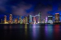 MIAMI, FLORIDA - CIRCA SEPTEMBER 2018: View of Downtown Miami, and Brickell Key from Key Biscayne at dusk.