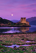 Image of the Eilean Donan Castle with moonrise in Loch Duich in the western Highlands of Scotland
