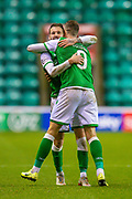 Martin Boyle of (#10) Hibernian FC is hugged by Christian Doidge (#9) of Hibernian FC after he scores his second goal during the Ladbrokes Scottish Premiership match between Hibernian FC and Aberdeen FC at Easter Road, Edinburgh, Scotland on 7 December 2019.