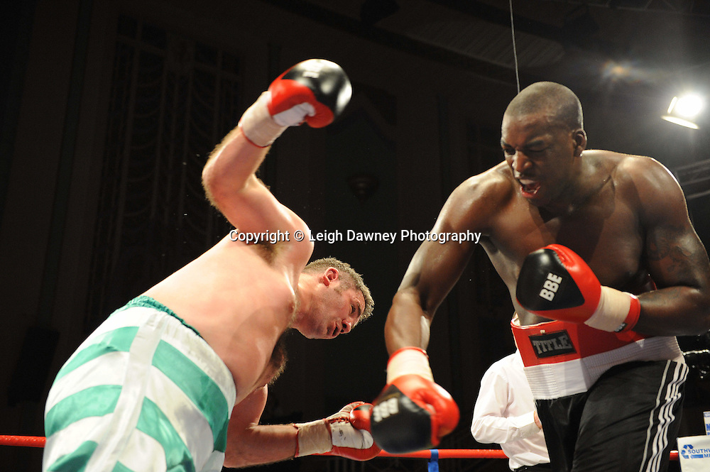 Damien Campbell (black shorts) draws with Colin Kenna at The Troxy, Limehouse, London, 16th October 2010. Frank Maloney Promotions © Photo credit: Leigh Dawney