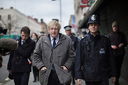 © licensed to London News Pictures. London, UK 25/03/2013.The Mayor of London Boris Johnson joins members of the Dalston Safer Neighbourhood Team on their local beat to launch the Mayor's Police and Crime Plan on Dalston Kingsland High street in London. Photo credit: Tolga Akmen/LNP