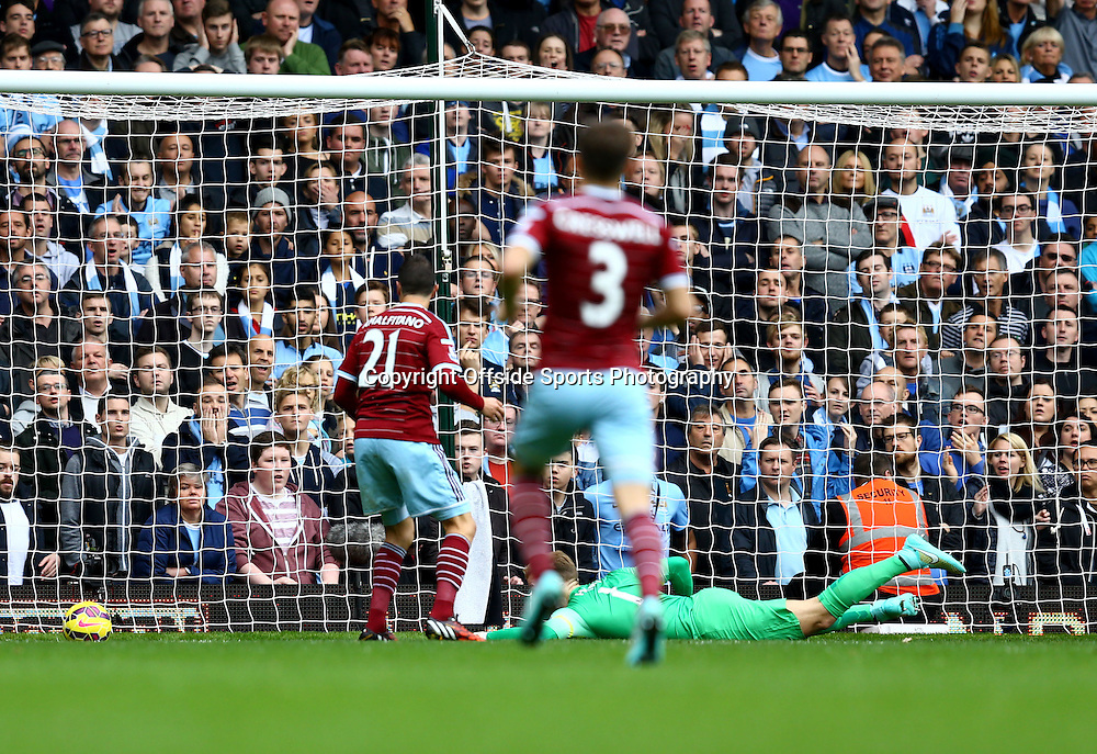 25 October 2014 - Barclays Premier League - West Ham v Manchester City - Morgan Amalfitano of West Ham scores the opening goal - Photo: Marc Atkins / Offside.