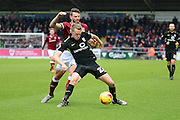 York City Defender Luke Hendrie holds off Northampton Town Midfielder Joel Byrom during the Sky Bet League 2 match between Northampton Town and York City at Sixfields Stadium, Northampton, England on 6 February 2016. Photo by Dennis Goodwin.