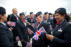 © London News Pictures. 04/07/2013 . London, UK.  British Airways staff carrying union flags as they wait for the new British Airways Boeing A380 superjumbo to arrive at Heathrow Airport. It was the first time British Airlines have taken delivery of the new plane, making British Airways the first European airline to operate both the 787 and A380. Photo credit : Ben Cawthra/LNP